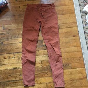 J brand skinny jeans in burnt orange.